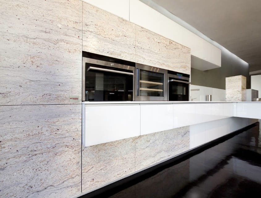 Arquitectura cocinando en un ambiente sofisticado stone for Levantina de granitos