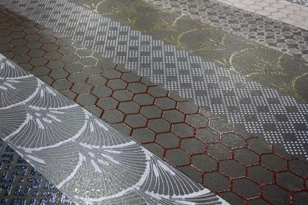 Nero Sicilia: Take a slab of black or gray basalt, apply granulated glass in desired pattern and burn the slab in a kiln.
