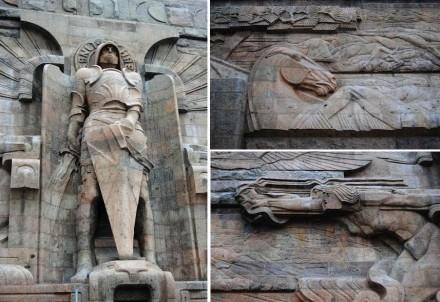 Der Erzengel Michael am Fuß des Denkmals. Umgeben ist die Figur von Reliefs von Kampfszenen.