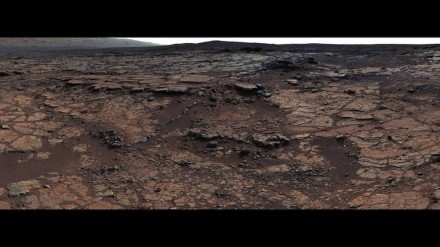 This mosaic of images from Curiosity's Mast Camera (Mastcam) shows geological members of the Yellowknife Bay formation. The scene has the Sheepbed mudstone in the foreground and rises up through Gillespie Lake member to the Point Lake outcrop. These rocks record superimposed ancient lake and stream deposits that offered past environmental conditions favorable for microbial life. Rocks here were exposed about 70 million years ago by removal of overlying layers due to erosion by the wind. Photo: NASA/JPL-Caltech/MSSS