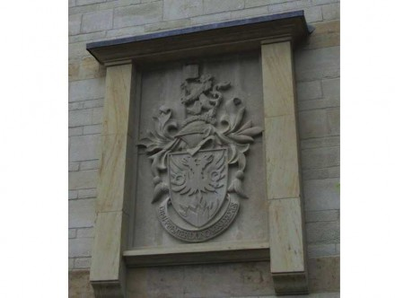 Coat of arms of Clayesmore school. Chicksgrove and Ham stone 1.2 m x 1.9 m.