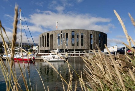 Akureyri's cultural center, is constructed in the shape of a drum and clad in Studlaberg granite, and is an eye catcher for disembarking visitors.
