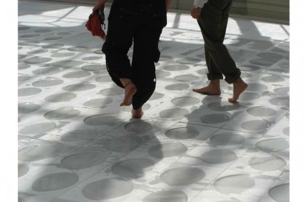 An Installation in Madrid in 2008 showed artist Evaristo Belotti's floor on which visitors were invited to walk barefoot through shallow pools of water on a marble surface. Photo: Federación Espanhola de la Piedra