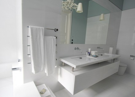 The dwelling boasts a total of 3 bathrooms: one in Italian Lasa marble...