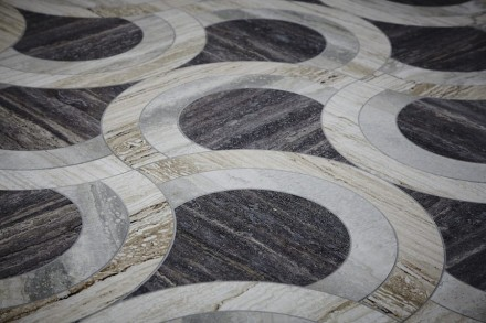 "Lapicida: ""Bespoke Vein Cut Travertine Floor""."