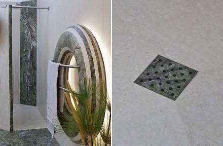 Originell auch der Handtuchhalter in Form eines Donuts beziehungsweise Rettungsrings (Serpentinit und Kalkstein) und der Ablauf für die Dusche.
