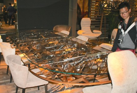 At Milan's grand Designer Trade Fair I Saloni, Italian-based Arteinmotion Company caught our eye by integrate parts of decommissioned airplanes in their new furniture, i.e. the lacy substructure of a wing imbedded in a glass table.