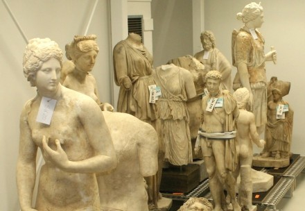 Ancient sculptures in a museum depot give an idea of the large variety of classical hairstyles.
