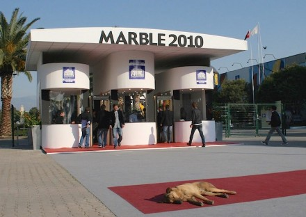 "Does natural stone attract animals? Stray dog at the main entrance of ""Marble"" Fair in Izmir, Turkey, 2010, early in the morning."