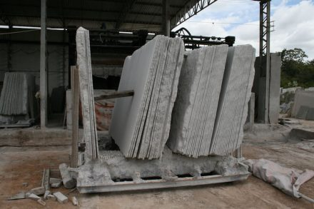 Huge amounts of stone powder result from cutting raw blocks into slabs.