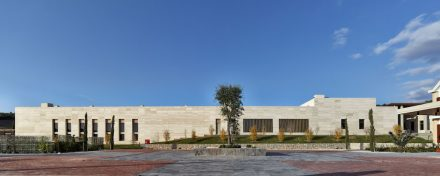 The elongated sides of the manufacturing complex are clad in travertine.
