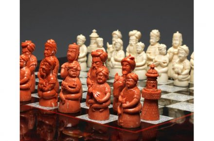 Carved Coral Figurative Chess Set.