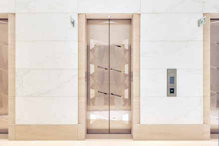 An eye-catcher: the hour-glass shapes adorning the elevator doors where the cones take on the appearance of arrowheads pointing upward and downward as if in joyous anticipation of a ride.