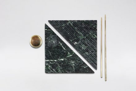 """Shih-Shih"": Taking advantage of marble's quality of cooling down temperature to keep raw food fresh, Shih-Shih uses the material as a raw food tray. It is consisted of trays, chopsticks and a saucer. When all the components are combined, is as a whole becomes a square. The jigsaw-shaped tray not only makes food breathable and less likely perishable, but is also more compatible with chopsticks. Designer: Wu Chen-Yi; manufacturer: Chia-Tai Marble Co., Ltd. / Stone and Resource Industry R&D Center; material: Serpentinite, brass."