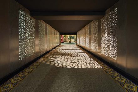 The entrance was accessible through a type of tunnel with Corian-clad walls designed in mashrabiya-style.