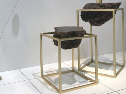 """Antivol"" is a side table made of lava blocks braced in a simple metal frame."