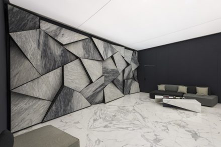 """Best Communicator Award, Stone, Italy: First Prize to Errebi Marmi """"for the astonishing grace of the marble surfaces protruding from the wall to enhance the chromatic characteristics of the material. Light and furnishing were chosen and designed to emphasize the identity of the project"""". Photo: Luca Morandini"""