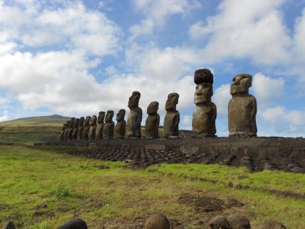 A restored statue platform with standing moai on the south coast of Rapa Nui. Note that one of the moai is adorned with a red scoria pukao. Photo: Sean Hixon