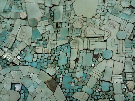 A reconstructed turquoise mosaic disk from Offering 99 in the Templo Mayor. Photo: Oliver Santana. Reproduced with permission from Editorial Rai?ces.