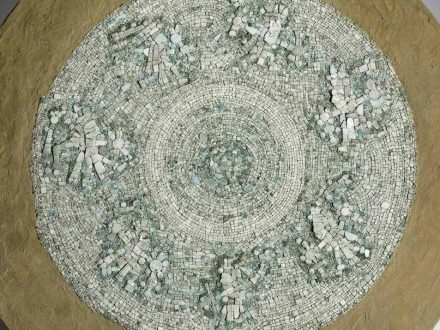 Close up view of Mixteca-style shield decorated with turquoise mosaic from the collections of the Smithsonian Institution-National Museum of the American Indian. Credit: Frances F. Berdan
