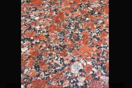 """Granite Kapustinsky, a coarse-grained rose-red granite with dark and light spots, quarried by <a href=""""http://www.stonex.ru/""""target=""""_blank"""">Stonex Group</a> (<a href=""""mailto:sataev@stonex.ru""""target=""""_blank"""">Mail</a>) close to Kapustinskoye in the Ucraine."""