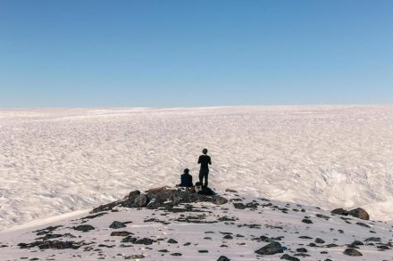Researchers from the Bristol Glaciology Centre look over the vast Greenland Ice Sheet. Photo: Dr. Jon Hawkings, University of Bristol