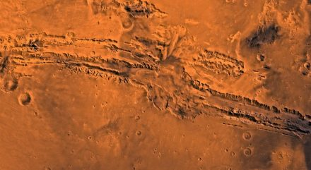 """Valles Marineris is a vast canyon system that runs along the Martian equator. At 4,500 km long, 200 km wide and 11 km deep, it is 10 times longer, 7 times wider and 7 times deeper than the Grand Canyon of Arizona. Source: NASA / JPL-Caltech / USGS / <a href=""""https://commons.wikimedia.org/""""target=""""_blank"""">Wikimedia Commons</a>"""