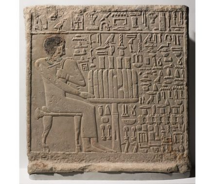 """Stela of Setju, ca. 2500-2350 B.C.E. Limestone, pigment. Perhaps tomb raiders or political enemies damaged his face and right arm in order to disable his source of nourishment and power in the next life, so that he could not seek retribution for their crimes against him. Source: <a href=""""https://www.brooklynmuseum.org/""""target=""""_blank"""">Brooklyn Museum</a>."""