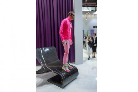 "Karim Rashid standing on one piece of ""Karim in Marble""."