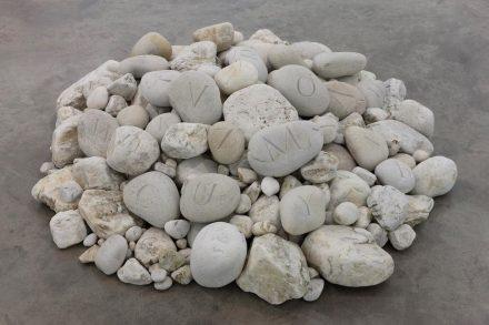"Dorothy Cross, ""Alphabet"", 2017, various quartz beach stones, 26 carved, 35 x 155 x 132 cm / 13.8 x 61 x 52 in approx."