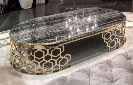 "Longhi: table ""Manfred"", with a base refering to traditional ""Mashrabiya"" decoration."