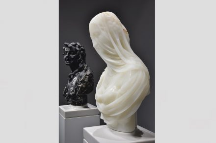 "Barry X Ball: ""Envy"", Portoro marble (behind), ""Purity"", white Iranian onyx"