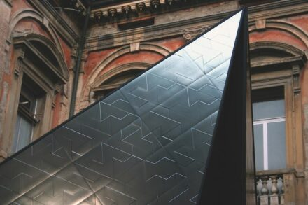 "The ""Fractile"" tiles made their debut in 2013 at Bologna Water Design, where they were used to clad Pinnacle, an installation placed in the 16th century Cortile del Priore at former maternity hospital to pay tribute to the verticality of medieval Bologna, its towers and historical buildings."
