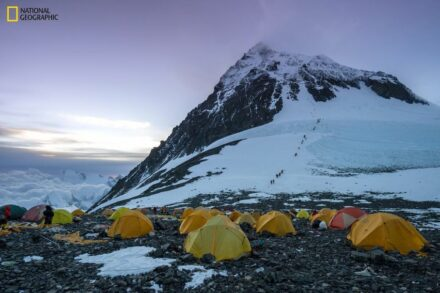 View of the scientists' tents at Camp IV/South Col. In the background, climbers make their way to the summit. Photo: Mariusz Potocki/National Geographic