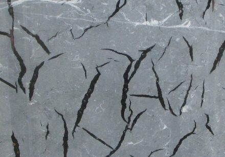 Proven solution of resin filtration control and mesh adhesion in marble and granite slabs.