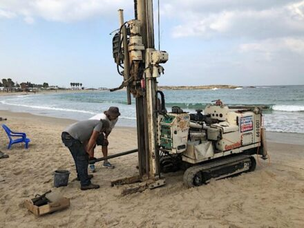 Geoprobe drilling rig extraction of a sediment core with evidence of a tsunami from South Bay, Tel Dor, Israel. Photo: T. E. Levy