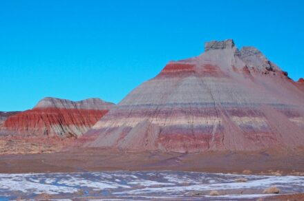 The colorful banded Tepees are part of the Blue Mesa Member, a geological feature about 220 million to 225 million years old in the Chinle Formation in Petrified Forest National Park in Arizona. Source: NPS
