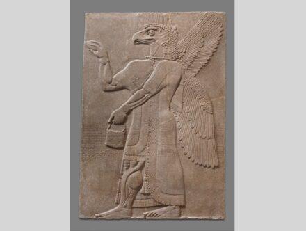 An Assyrian relief panel of a supernatural figure.