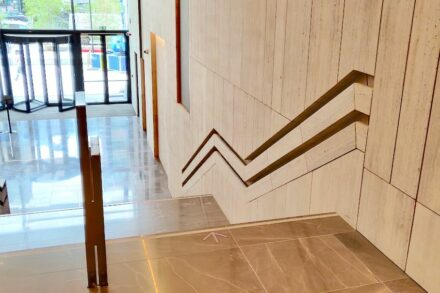 Travertine handrails in the renovated Manhattan Center in Brussels.
