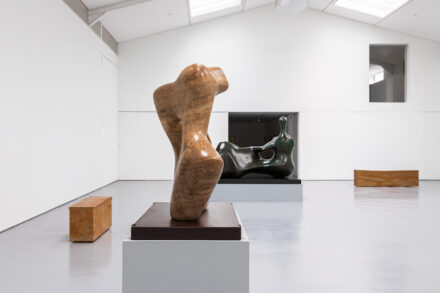 """Installation view with Henry Moore, """"Mother and Child"""", 1978, stalactite, """"Reclining Figure: Hand"""", 1979, bronze and Edmund de Waal, """"tacet X and XIII"""", Hornton stone, 2020. Reproduced by permission of the Henry Moore Foundation, Edmund de Waal and New Art Centre, Wiltshire. Photo: Alzbeta Jaresova"""