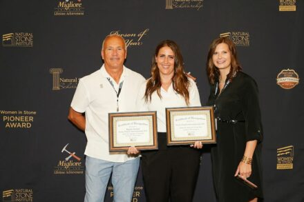 Kayla Strand (center) accepts the award from Education Committee Chair Daniel Wood and CEU Administrator Sarah Gregg.