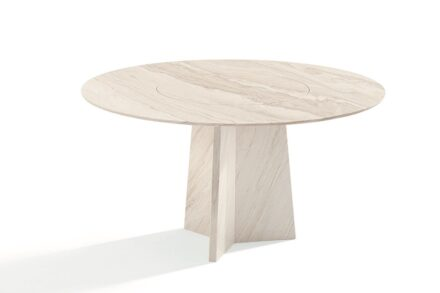 """Draenert: The table with three-wing base made of natural stone. In this variant, the rotating piece is integrated into the top. The name of the table is then """"Tadao""""."""