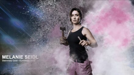 """Stonemason Melanie Seidl as """"Heroine"""" in the poster campaign of the Austrian Economy Chamber."""
